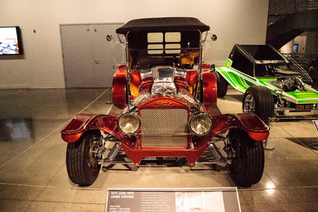 restored: Los Angeles, CA, USA - July 23, 2017: Red candy colored 1923 Ford Model T Roadster called Candy Root Beer displayed at the Petersen Automotive Museum. Editorial use.