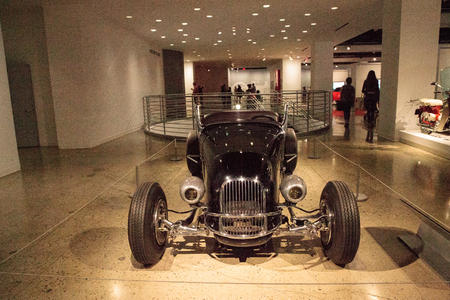 Los Angeles, CA, USA - July 23, 2017: Black 1927 Ford Model T Custom Roadster by Frank Mack displayed at the Petersen Automotive Museum. Editorial use.