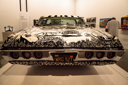 Los Angeles, CA, USA - July 23, 2017: Black and white 1968 Chevrolet Impala lowrider called El Muertorider by artists Artemia Rodriguez and John Jota Leanos displayed at the Petersen Automotive Museum. Editorial use.