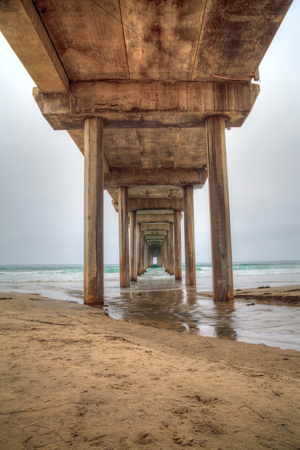 Under the Scripps pier in La Jolla, California at the end of Summer