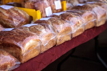Line of freshly baked homemade bread at a farmers market Stok Fotoğraf