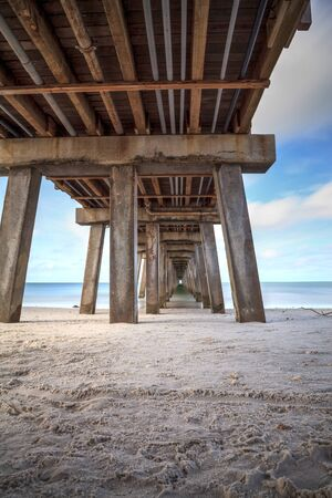 Long exposure of Naples Pier, Florida in the fall with the ocean smoothed out and HDR applied