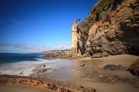 Tower over Rocky shores at Victoria Beach in Laguna Beach, California on a sunny day Reklamní fotografie