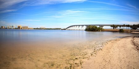 View from the beach of Sanibel Causeway bridge, which crosses San Carlos Bay to lead into Sanibel Island, Florida Stock Photo