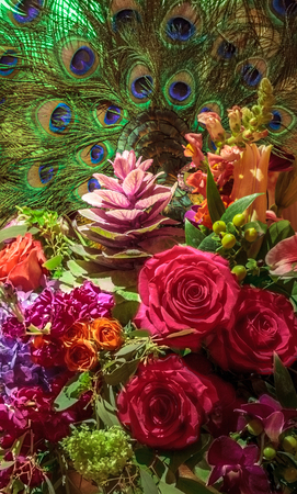 Fresh bouquet of roses, rubrum lily, hydrangea, and assorted blooms with a party mask. Stock Photo