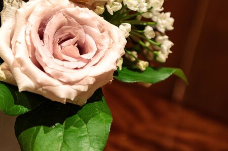Light purple rose called a sterling silver rose bouquet in a glass vase.