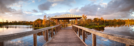 Sunset over Gazebo on a wooden secluded, tranquil boardwalk along a marsh pond in Freedom Park in Naples, Florida