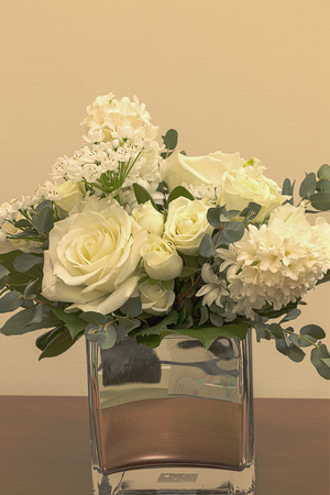 White wedding bouquet of flowers including roses white lilac stock photo white wedding bouquet of flowers including roses white lilac hydrangea star of david and hyacinth in a reflective mirror vase mightylinksfo