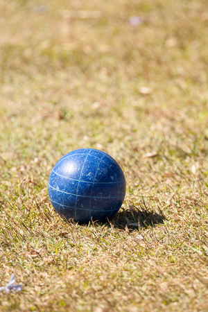 Bocce ball on the green grass of an open field ready for sport in Naples, Florida Stock Photo