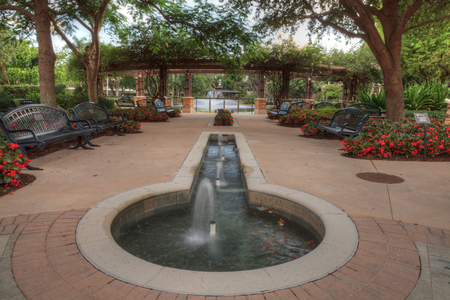 Fountain and entryway of the Garden of Hope and Courage memorial garden and sanctuary Stock Photo