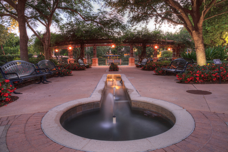 Nighttime fountain and entryway of the Garden of Hope and Courage memorial garden and sanctuary Stock Photo