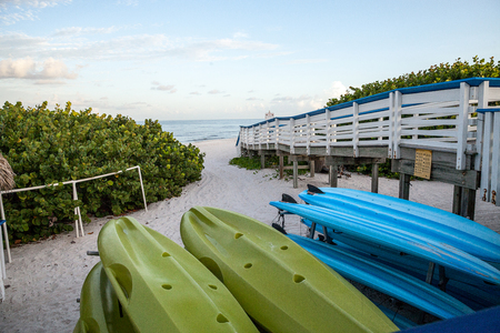 Kayaks along the sand at Clam Pass Beach in Naples, Florida