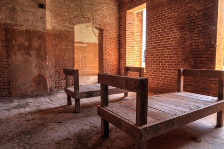 Wooden beds for the soldiers at Fort Zachary Taylor in Key West, Florida along the coastline.