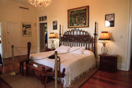 Key West, Florida, USA - September 1, 2018: Cat sleeps on the bed in the bedroom of Ernest Hemingway's House in Key West, Florida. For editorial use.