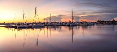 Sunrise over a quiet harbor in old Naples, Florida during the summer