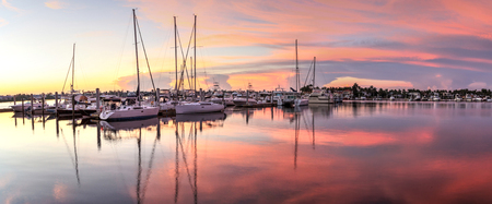 Sunrise over a quiet harbor in old Naples, Florida during the summer Stok Fotoğraf
