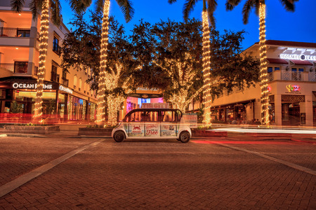 Naples, Florida, USA – September 16, 2018: Sunset over the glittering white lights around The Naples Players Community Theater on 5th Street where the Tin City courtesy shuttle bus stops in old Naples, Florida Editorial