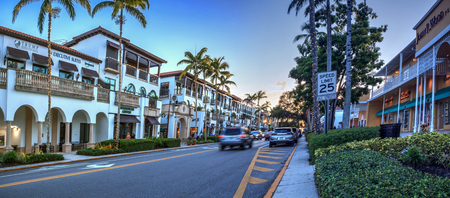 Naples, Florida, USA – September 16, 2018: Sunset over the shops along 5th Street in Old Naples, Florida.