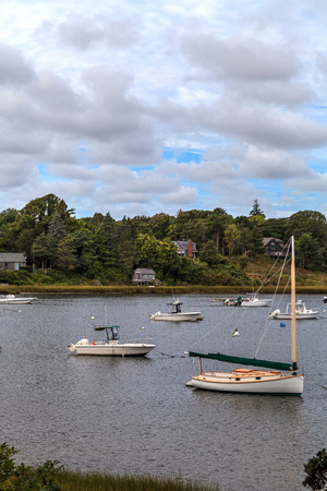 New Orleans, Cape Cod, Massachusetts, USA – September 12, 2015: Sailboats and fishing boats anchor in a harbor in New Orleans on Cape Cod at the end of Summer.