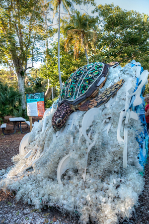 Naples, Florida, USA – December 23, 2018: Natasha the Turtle Sculpture made of garbage found in the ocean as part of the Washed Ashore art exhibit and environmental movement showcased at the Naples Zoo. Фото со стока
