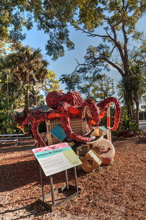 Naples, Florida, USA – December 23, 2018: Octavia the Octopus Sculpture made of garbage found in the ocean as part of the Washed Ashore art exhibit and environmental movement showcased at the Naples Zoo.