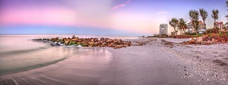 Sunrise over North Gulf Shore Beach along the coastline of Naples, Florida