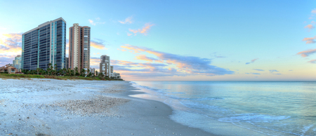 Sunrise over North Gulf Shore Beach along the coastline of Naples, Florida