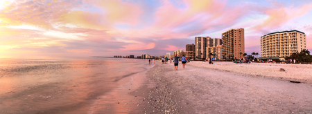 Pink and gold sunset sky over South Marco Island Beach in Florida