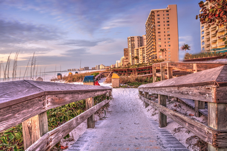 Boardwalk leading down to South Marco Island Beach at Sunset in Florida Stock Photo