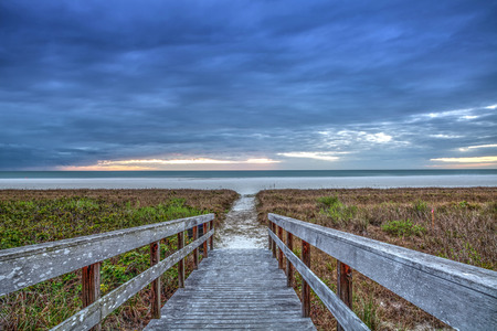 White sand path leading through the beach grass at Tigertail Beach at sunset on Marco Island, Florida. Stock Photo