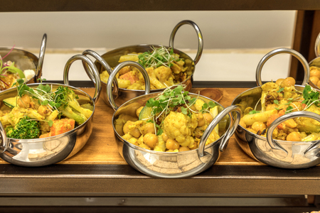 Cauliflower Curry salad in individual bowls at a buffet dinner or lunch.