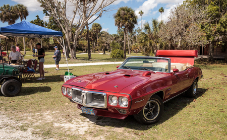 Estero, Florida, USA - February 23, 2019:  Red 1967 Pontiac Firebird at the 10th Annual Classic Car and Craft Show at historic Koreshan State Park.