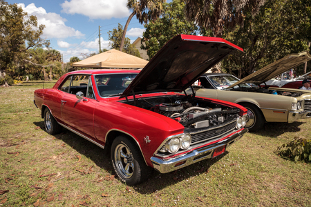 Estero, Florida, USA - February 23, 2019:  1966 Red 327 Chevrolet Malibu at the 10th Annual Classic Car and Craft Show at historic Koreshan State Park. 報道画像