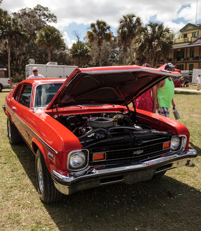 Estero, Florida, USA - February 23, 2019:  Red 1973 custom Chevrolet Nova SS 350 Coupe at the 10th Annual Classic Car and Craft Show at historic Koreshan State Park. 報道画像