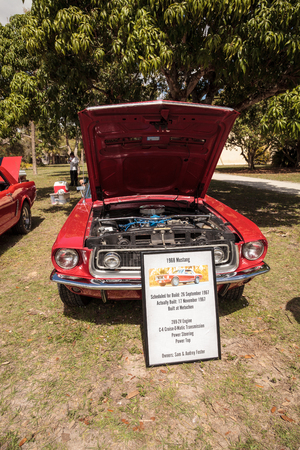 Estero, Florida, USA - February 23, 2019:  Red 1968 Ford Mustang at the 10th Annual Classic Car and Craft Show at historic Koreshan State Park. Editorial Use.
