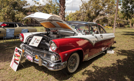 Estero, Florida, USA - February 23, 2019:  Red and White 1955 Ford Crown Victoria Skyliner at the 10th Annual Classic Car and Craft Show at historic Koreshan State Park. Editorial Use.