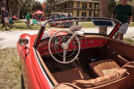 Estero, Florida, USA - February 23, 2019:  Red 1957 Mercedes Benz 190SL at the 10th Annual Classic Car and Craft Show at historic Koreshan State Park. Editorial Use.