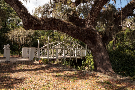 Estero, Florida, USA - February 23, 2019: Old wooden bridge along the riverway at historic Koreshan State Park.
