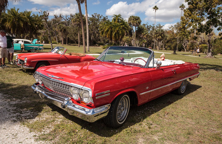 Estero, Florida, USA - February 23, 2019:  Red 1963 Chevrolet Impala convertible at the 10th Annual Classic Car and Craft Show at historic Koreshan State Park.
