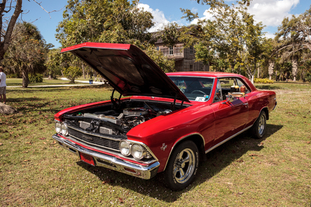 Estero, Florida, USA - February 23, 2019:  1966 Red 327 Chevrolet Malibuat the 10th Annual Classic Car and Craft Show at historic Koreshan State Park.