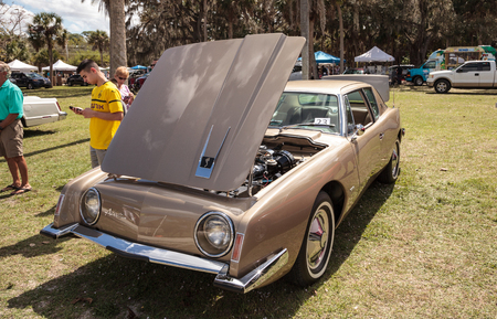 Estero, Florida, USA - February 23, 2019:  Gold 1963 Studebaker Avanti at the 10th Annual Classic Car and Craft Show at historic Koreshan State Park. Editorial
