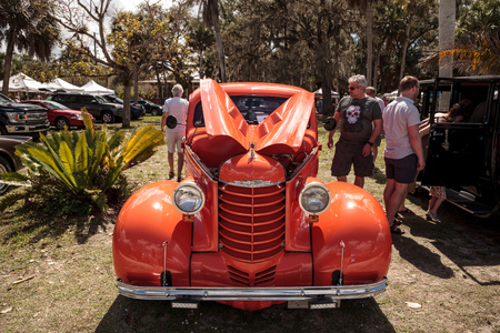Estero, Florida, USA - February 23, 2019:  Orange 1937 Oldsmobile Eight at the 10th Annual Classic Car and Craft Show at historic Koreshan State Park. Editorial Use.