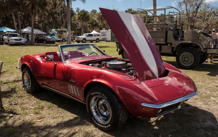 Estero, Florida, USA - February 23, 2019:  Red 1969 Chevrolet corvette stingrayconvertible at the 10th Annual Classic Car and Craft Show at historic Koreshan State Park.
