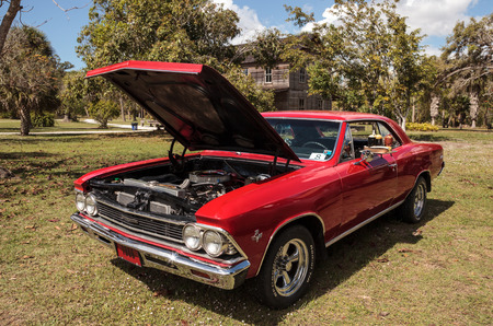 Estero, Florida, USA - February 23, 2019:  1966 Red 327 Chevrolet Malibu at the 10th Annual Classic Car and Craft Show at historic Koreshan State Park. Editorial