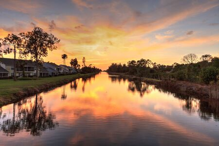 Golden sunset over a Gordon River tributary that winds through Golden Gate in Naples, Florida.