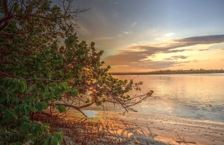 Waterway that leads to the ocean on Isle of Capri near Marco Island, Florida at Sunset.