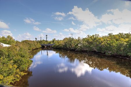Blue sky and clouds over Henderson Creek, which runs through Rookery Bay in Marco Island, Florida 写真素材