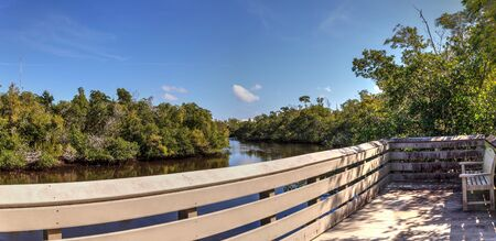 Blue sky and clouds over a bridge that crosses Henderson Creek, which runs through Rookery Bay in Marco Island, Florida