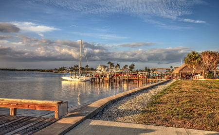 Sailboats in a riverway that leads to the ocean on Isle of Capri near Marco Island, Florida at Sunset.