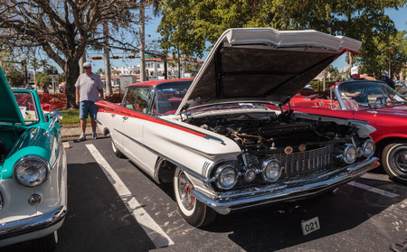 Naples, Florida, USA – March 23,2019: White 1959 Oldsmobile 98 at the 32nd Annual Naples Depot Classic Car Show in Naples, Florida. Editorial only.